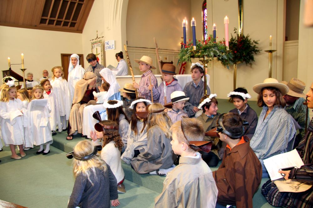 a group of children dressed up for a nativity pageant